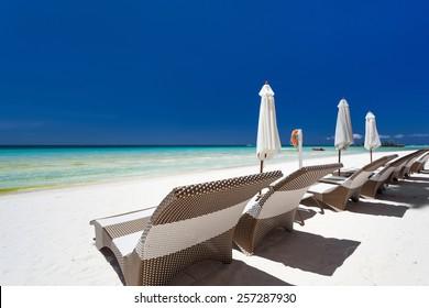 Sun umbrellas and beach chairs on a beautiful island, Philippines, Boracay