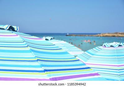 Sun umbrellas in the Fig Tree bay, Cyprus