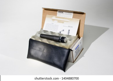 SUN VALLEY, CALIFORNIA / USA - JANUARY 28 2010: Shure Model SM57 Microphone with leather case and foam-padded box tabletop photograph for eBay.