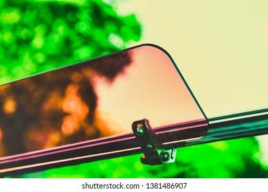 Sun visor in a convertible on a summer day
