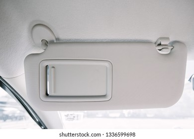 Sun visor with mirror in a car.