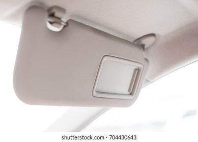 Sun visor with mirror in a car