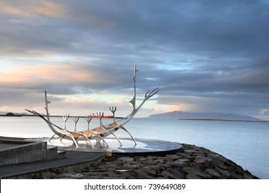 Sun Voyager monument, clouds, landmark of Reykjavik city.