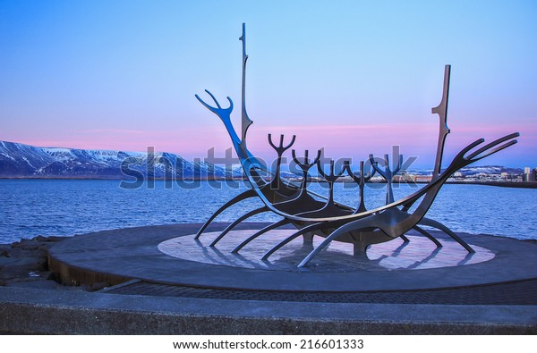 Sun Voyager monument, landmark of Reykjavik city, designed by Jon Gunnar Arnason, at the clear spring evening  with sea and mountains in background in Reykjavik, Iceland