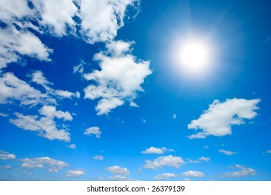 Sun and white clouds in sky