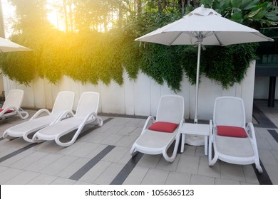 sunbath chairs near the pool ideal for travel and vacation concept.