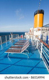 sunbath chairs on upper deck of cruise liner