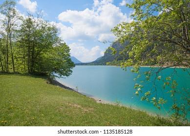 sunbathing area at lakeshore of accumulation lake sylvenstein, beautiful landscape upper bavaria