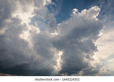 Sunbeam between storm clouds cloudscape sky view