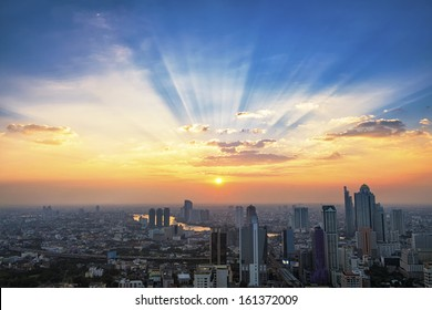 Sunbeam and cityscape at sunset in Bangkok, Thailand