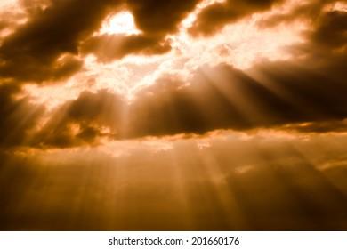 Sunbeam with clouds in orange sky