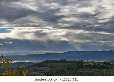 Sunbeam penetrating grey skies over the Black Mountains in the Tarn in Southern France