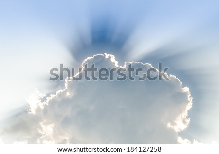 Sunbeam through the haze on blue sky: can be used as background and dramatic look, Ray of lights through the clouds