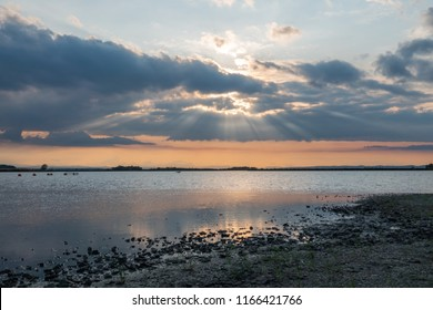 Sunbeams come through the clouds at Zicksee in Burgenland