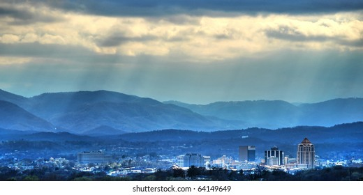 Sunbeams on the city- The sun cuts through the clouds over the city of Roanoke, VA