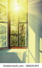 Sunbeams passing through vintage window into room