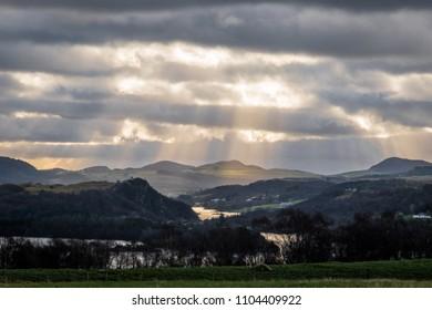 Sunbeams shining through clouds Norway