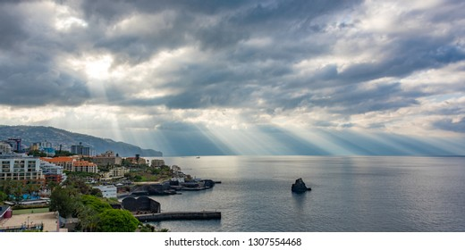 Sunbeams Through The Clouds After Rain Shower at Madeira