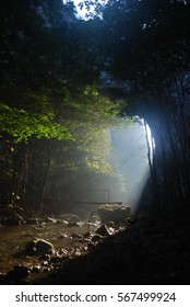 Sunbeams through Rock in the morning under a mystic river. Dramatic colorful scenery. Secret river.