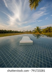 Sunbed in the swimming pool, South Goa in India