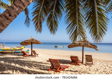 Sunbeds and deckchairs under the palm tree on Ifaty beach, southwest Madagascar