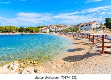 Sunbeds on beautiful beach in Primosten old town, Dalmatia, Croatia