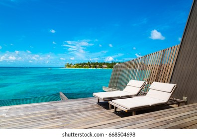 sunbeds on a deck on an tropical island