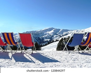 sunbeds for relaxation, beautiful winter landscape with mountain view