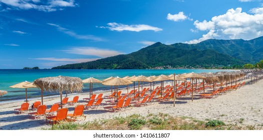 Sunbeds and umbrella on amazing Golden Beach at Thassos, Aegean Sea, Greece