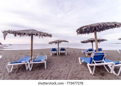 Sunbeds and Umbrella on a Tropical Beach