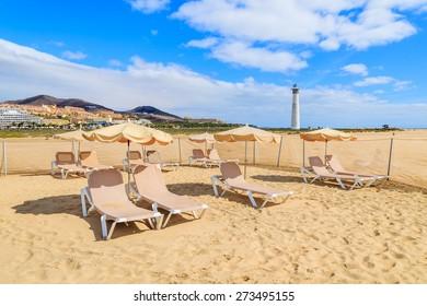 Sunbeds with umbrellas on Jandia beach, Fuerteventura, Canary Islands, Spain
