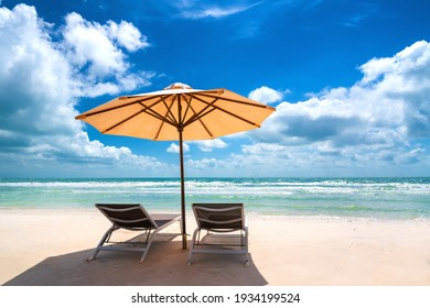 Sunbeds under tropical palms on beach on Phu Quoc island, Vietnam. Beach's smile