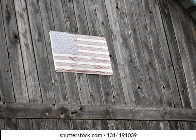 Sun-Bleached Old Glory on weathered hand-hewn Mennonite barn