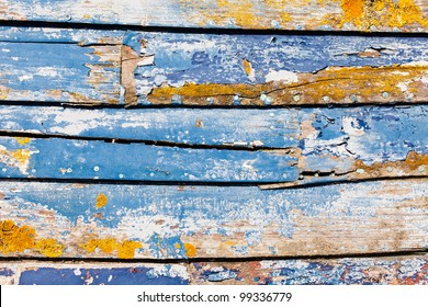 Sun-Bleached Peeling Paint on an Old Wooden Boat