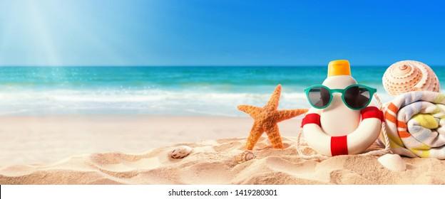 Sunblock Bottle on the tropical beach and sunshine
