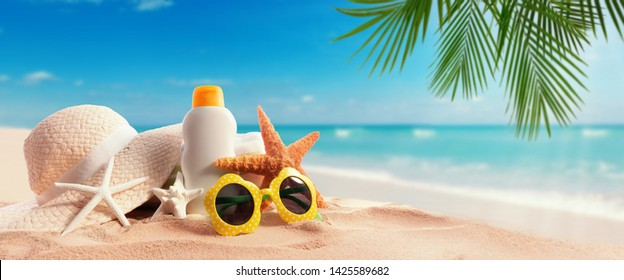 Sunblock Bottle on the tropical beach and sunshine