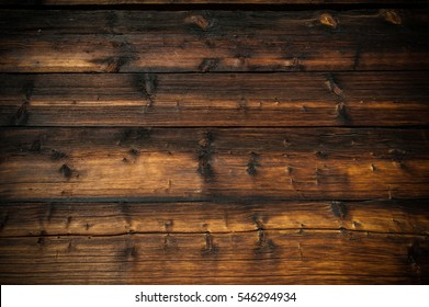 sunburned and weathered planks of wood of a barn background
