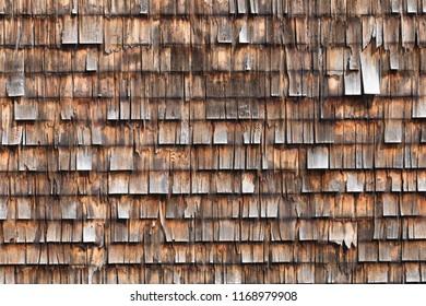 sunburnt wooden shingles an a wall
