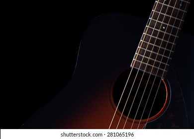sunburst acoustic guitar & beautiful rim light of six strings, frets and body shape, isolated on black for music background