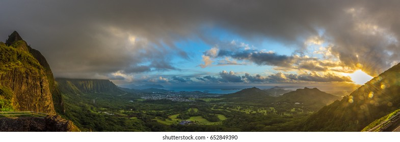 sunburst and bokeh at sunrise over the winward side of the island of oahu hawaii with beautiful panoramic views of the koolau mountain range , kaneohe bay and kailua