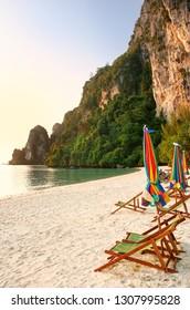 Sunchairs and umbrellas on Ao Ton Sai beach, Phi Phi Don Island, Krabi Province, Thailand. Koh Phi Phi Don is part of a marine national park.