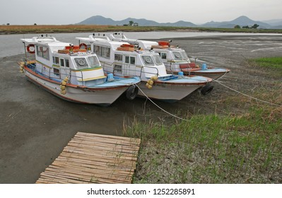Suncheon, South Korea - April 30, 2011: Boats a beach in some beautiful wetlands. Taken in Suncheon, South Korea, but suitable to illustrate boating, wetlands, fishing, or beauty in nature.