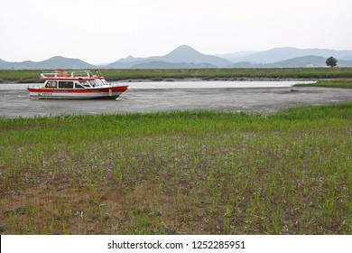 Suncheon, South Korea - April 30, 2011: A boat on a beach in some beautiful wetlands. Taken in Suncheon, South Korea, but suitable to illustrate boating, wetlands, fishing, or beauty in nature.