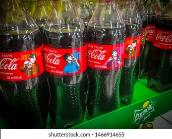 Suncheon, South Korea - August 18, 2018: A closer look at the BTS Special Edition Coke bottles being sold at a supermarket (HomePlus) in South Korea.