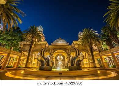 SUNCITY, SOUTHAFRICA - DEC 25,2015 : On the Christmas night, Long exposure night shot of SABLE FOUNTAIN at the entrance of The Palace of The Lost City with the moving palm leaves.