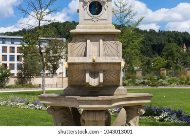 sunclock at a historical rokoko park in south germany july summer day with blue sky