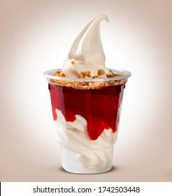 Sundae with strawberry syrup. Ice cream.