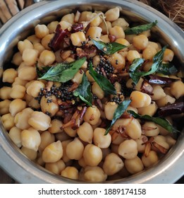 Sundal - Traditional South Indian dish made with chikpeas, roasted coconut slices, curryleaves, herbs and spices. It is a very healthy and a high protien snack