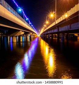 Sundale Bridge on the Gold Coast at night.  Looking through the middle of the two bridges