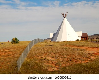 Sundance, Wyoming, USA - September 20, 2016: Giant white Native American teepee house at the Vore Buffalo Jump archaeological site of northeast Wyoming